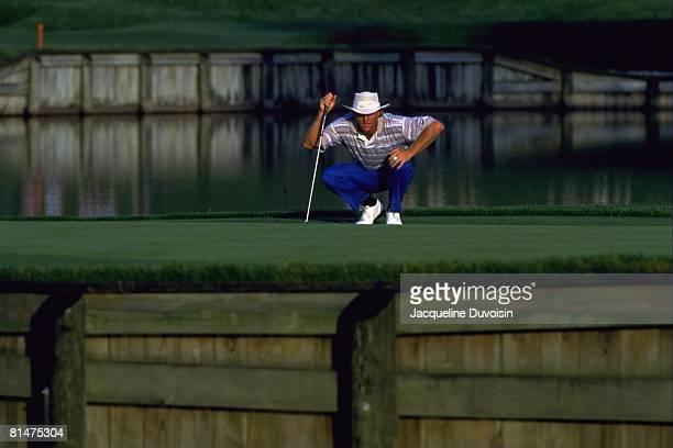 Golf: The Players Championship, Greg Norman lining up putt on Thursday at TPC Sawgrass, Ponte Vedra, FL 3/24/1994