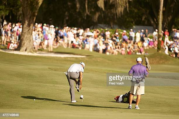 The Players Championship Tiger Woods adjusts his sock on No 16 hole during Thursday play at Stadium Course of TPC Sawgrass Ponte Vedra Beach FL...