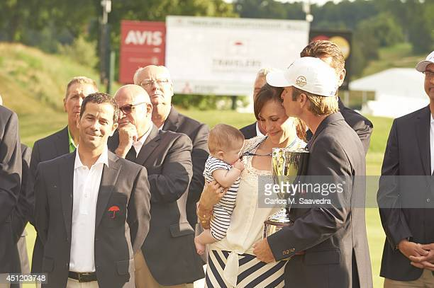 Travelers Championship Kevin Streelman victorious with his wife Courtney and their 6monthold daughter Sophia while holding trophy after winning...