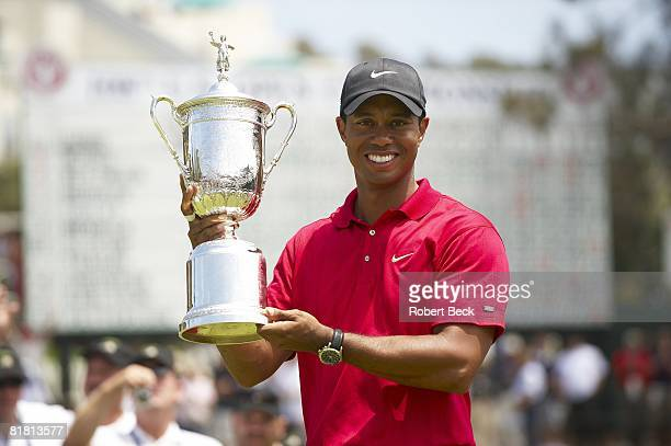Closeup of Tiger Woods victorious with trophy after winning Monday playoff round vs Rocco Mediate at Torrey Pines GC. La Jolla, CA 6/16/2008 CREDIT:...