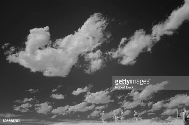 Infrared view of Justin Rose, Jason Day and Rory McIlroy walking during Thursday play at Erin Hills GC. Hartford, WI 6/15/2017 CREDIT: Robert Beck