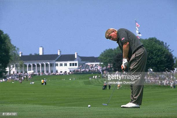 Golf: US Open, John Daly in action, making putt on Thursday at Oakland Hills CC, Bloomfield Hills, MI 6/13/1996