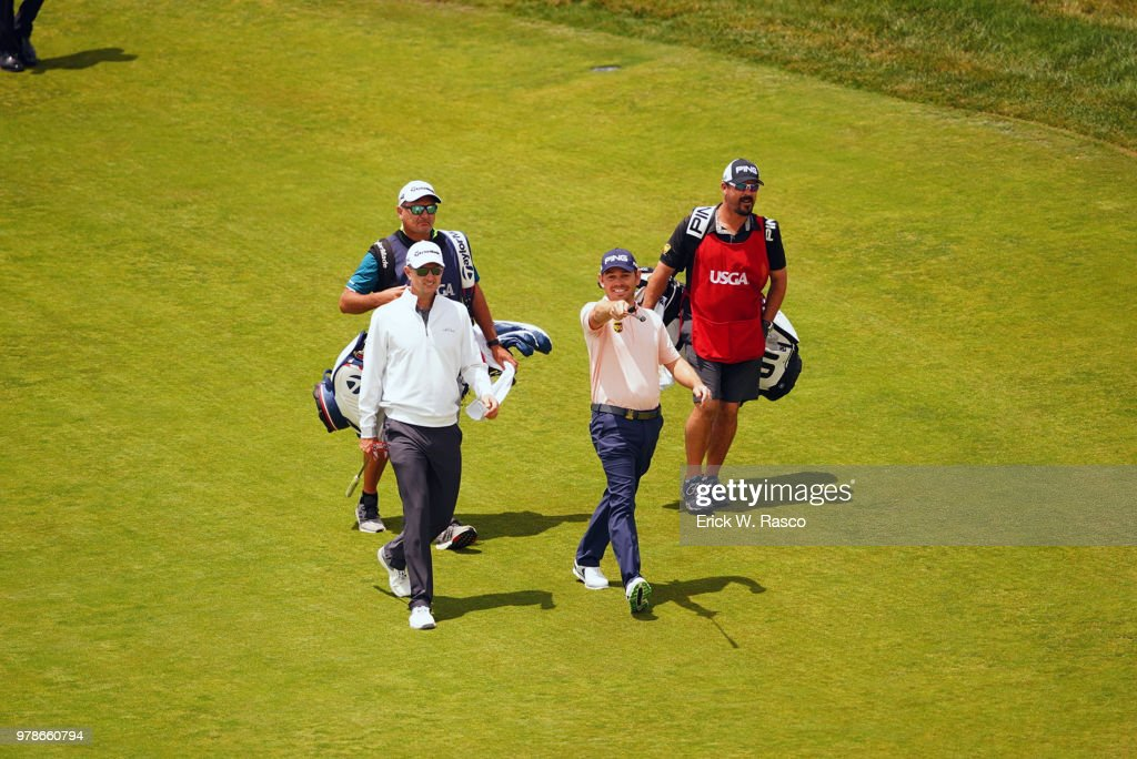 Justin Rose walking with Louis Oosthuizen on fairway during