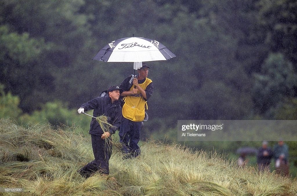 Phil Mickelson in action from rough on Friday at Bethpage Black. Rain, weather. Farmingdale, NY 6/14/2002