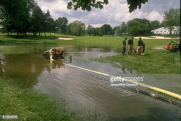 Golf US Open Scenic view of flooded course after rain delay weather with groundskeepers removing water with pump before Thursday play at Oakland...