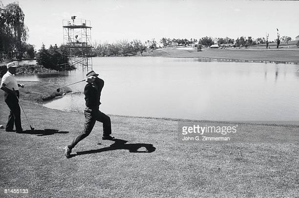 Golf US Open Scenic view of Tommy Bolt upset tossing club after hitting two shots into water at Cherry Hills CC Denver CO 6/17/1960
