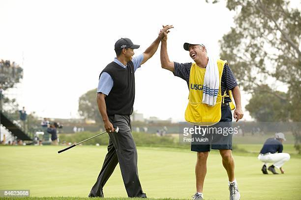 US Open Tiger Woods victorious with caddie Steve Williams after eagle chip on No 13 during Saturday play at Torrey Pines GC La Jolla CA 6/14/2008...
