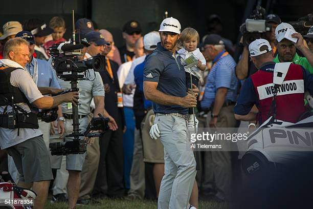 US Open View of Dustin Johnson with son Tatum during trophy presentation on Sunday at Oakmont CC Oakmont PA CREDIT Al Tielemans