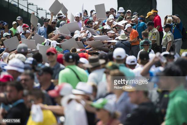 View of Rory McIlroy signing autographs for spectators during Wednesday practice at Erin Hills GC. Hartford, WI 6/14/2017 CREDIT: Robert Beck