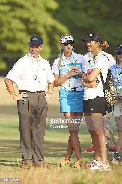 View of USGA executive director Mike davis and LPGA pros Jessica Korda and Michelle Wie looking on from sidelines during Sunday play at Course No. 2...