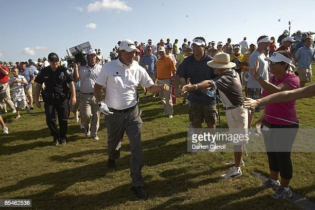 WGC CA Championship Phil Mickelson fist bump with fans in gallery after Sunday play at Blue Monster Course of Doral Resort Spa Doral FL 3/15/2009...