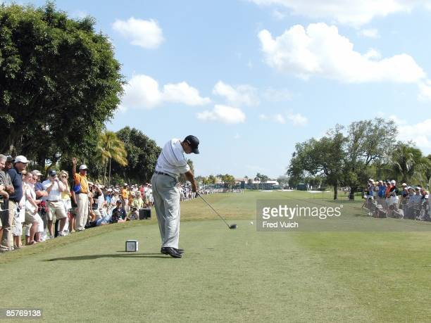 WGC CA Championship Rear view of Tiger Woods in action drive from tee on Thursday at Blue Monster Course of Doral Resort Spa Sequence Doral FL...