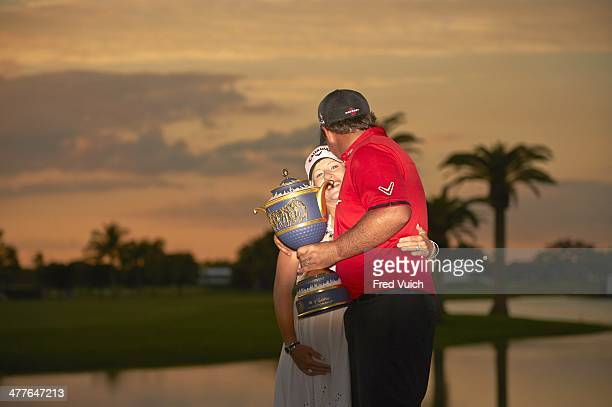 WGC Cadillac Championship Patrick Reed and his wife Justine victorious with Gene Sarazen Cup trophy after winning tournament on Sunday at TPC Blue...