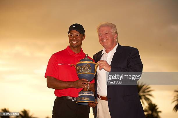 WGC Cadillac Championship Tiger Woods victorious with Donald Trump holding Gene Sarazen Cup trophy after winning tournament on Sunday at TPC Blue...