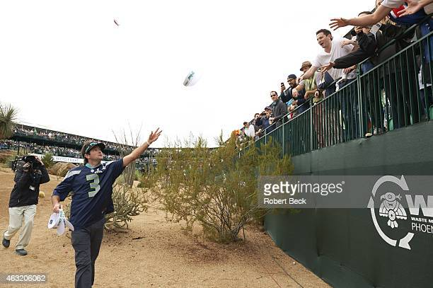 WM Phoenix Open Bubba Watson greets fans in gallery on No 16 hole while wearing Seattle Seahawks jersey during Saturday play at TPC Scottsdale...
