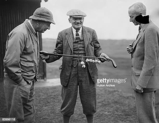 Golf writer Bernard Darwin holds the president's putter at the Oxford and Cambridge Society Golf tournament in Rye January 1932 Both he and R A de...