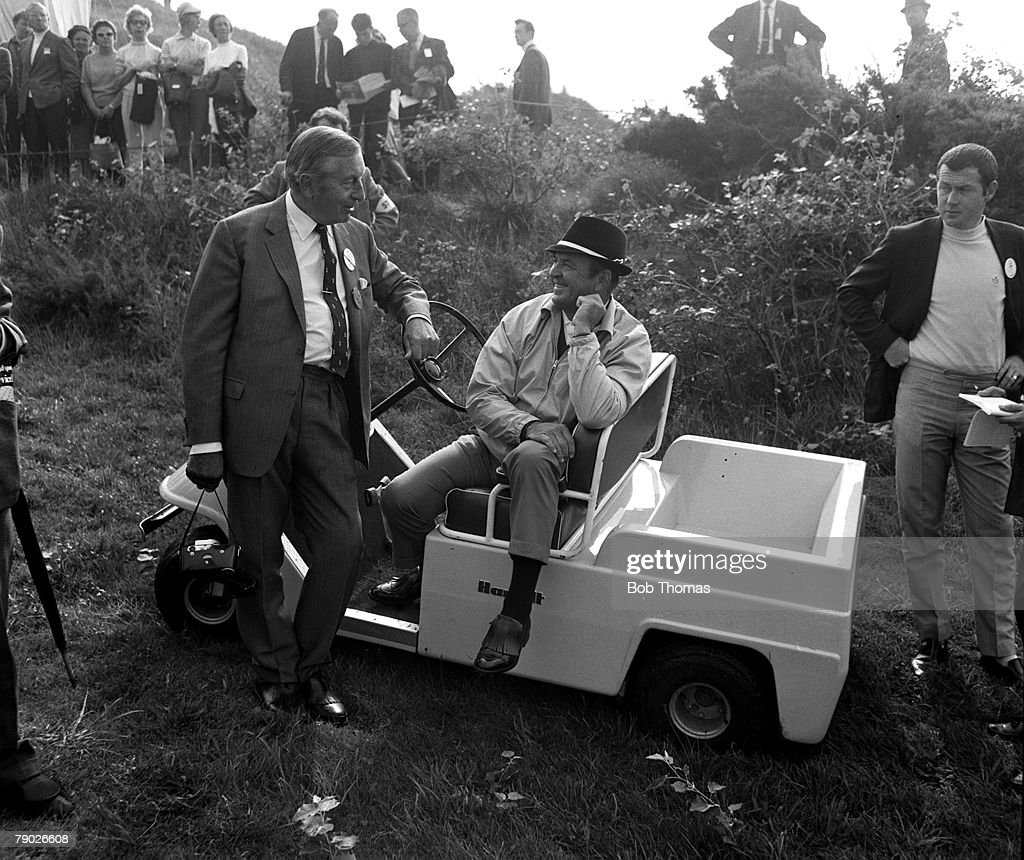 Golf.1969 Ryder Cup. Royal Birkdale. U.S.A captain Sam Snead chatting to Great Britain's Henry Cotton from a golf buggy. : News Photo