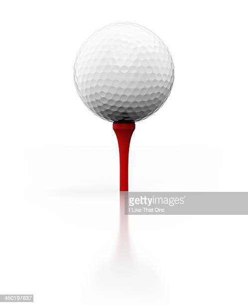 Golfball and red golf tee