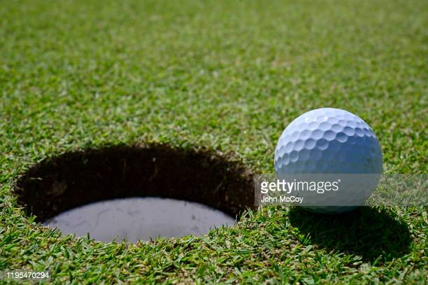 Golfball inches from the cup on the 14th green at the Coco Beach Championship course on December 18, 2019 in Rio Grande, Puerto Rico.