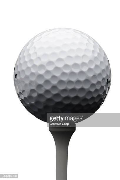 golfball on tee - tee sports equipment stock photos and pictures
