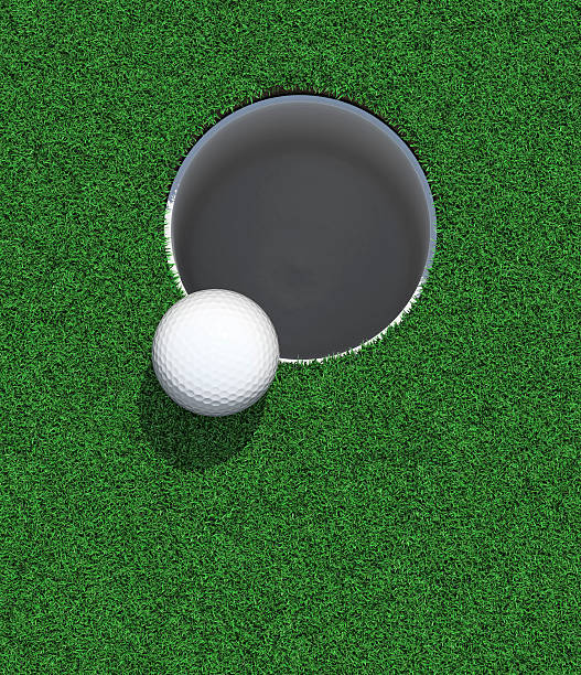 Golfball on the lip of the cup / hole