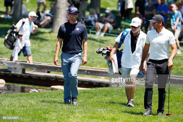 PGA golfer Adam Scott and Jason Day walk to the 9th green during the Memorial Tournament Second Round on June 02 2017 at Muirfield Village Golf Club...