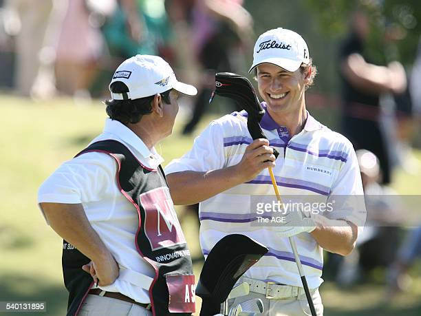 Golfer Adam Scott has a laugh with his caddie on the 16th hole, on 19th November 2006. THE AGE SPORT. Picture by .