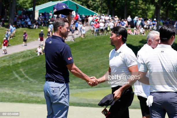 PGA golfer Adam Scott shakes hands with Jason Day after finishing on the 9th hole during the Memorial Tournament Second Round on June 02 2017 at...