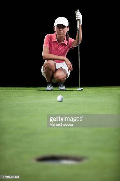 golfer aiming her putt - women's golf stock pictures, royalty-free photos & images