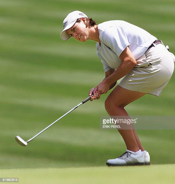 Golfer AJ Eathorne of Canada watches her par putt go in on the 18th hole 31 May 2001 as she finishes the first round of the US Women's Open at the...