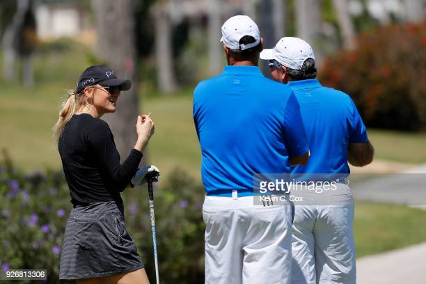 TOUR golfer Amanda Blumenherst speaks with fans on the 16th hole during the second day of the Puerto Rico Open Charity ProAm at TPC Dorado Beach on...