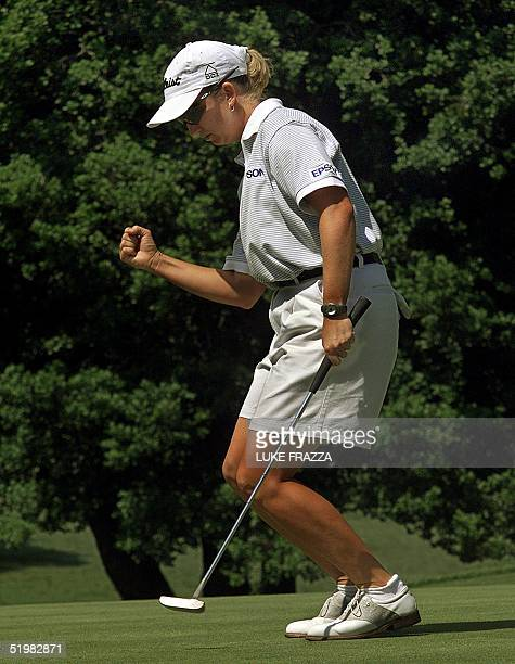Golfer and defending US Women's Open Champion Karrie Webb of Australia reacts to her birdie putt on the 7th hole 2001 during the final round of the...