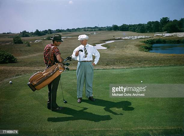 A golfer and his caddy prepare to tee off at the National Golf Links of America Southampton New York in 1950 This photo was shot for the story...