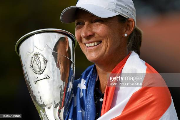 US golfer Angela Stanford poses with her trophy after winning the Evian Championship in the French Alps town of EvianlesBains on September 16 2018