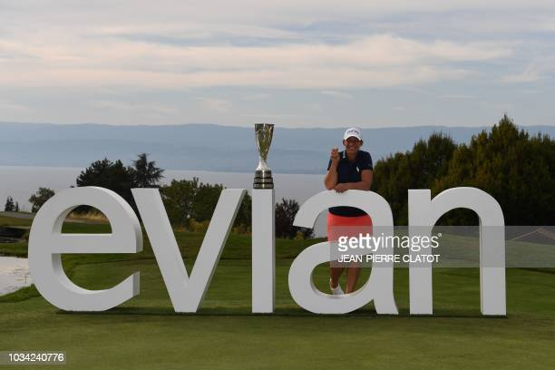 US golfer Angela Stanford poses with her trophy next to an Evian sign after winning the Evian Championship in the French Alps town of EvianlesBains...