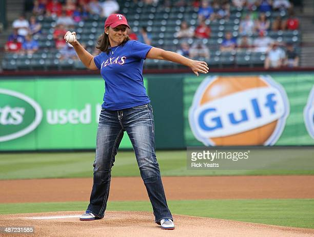 LPGA golfer Angela Stanford throws the ceremonial first pitch before the start of the game between the Texas Rangers and the Oakland Athletics at...