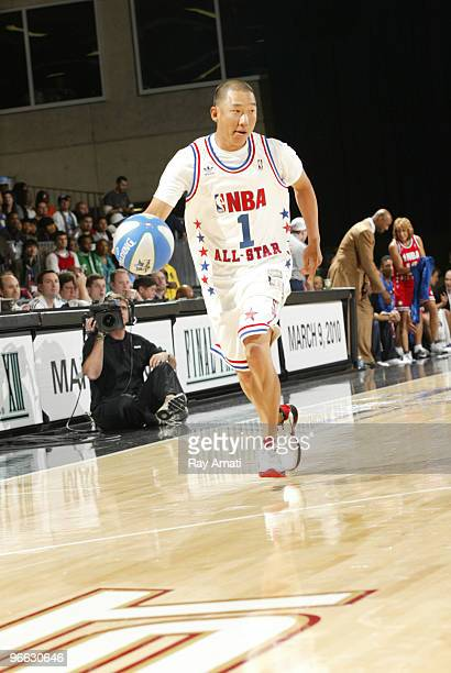 Golfer Anthony Kim dribbles during the 2010 NBA AllStar Celebrity Game presented by FINAL FANTASY XIII on center court during NBA Jam Session...