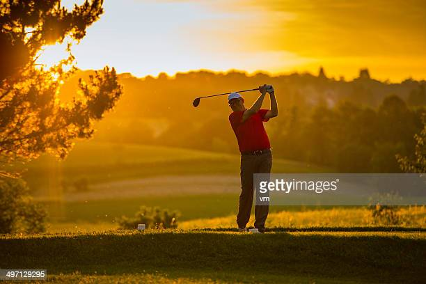 golfer at sunset - teeing off stock pictures, royalty-free photos & images