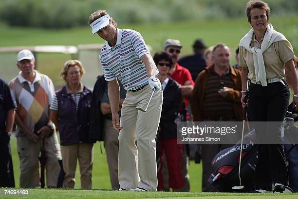 Golfer Bernhard Langer hits a shot during the opening of Hartl Golf Resort on June 18 in Penning Germany