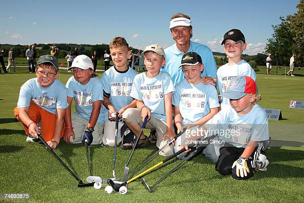 Golfer Bernhard Langer poses with children during the opening of Hartl Golf resort on June 17 in Penning Germany