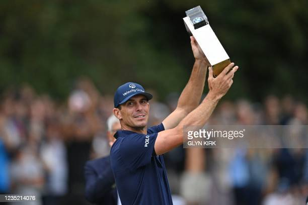 Golfer Billy Horschel celebrates with the trophy after his victory in the PGA Championship at Wentworth Golf Club in Surrey, south west of London on...