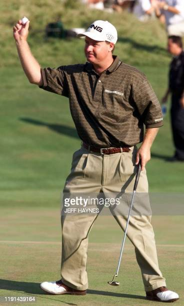 Golfer Bob May of the US reacts after making the final putt on the 18th hole 20 August, 2000 to force a playoff in the 82nd PGA Championship at...
