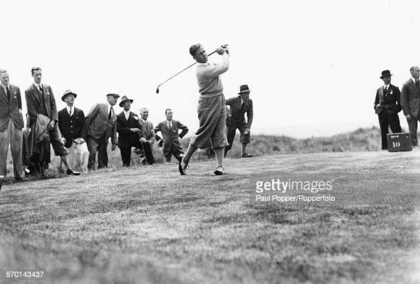Golfer Bobby Jones is watched by a crowd as he plays in the Open Golf Championships at Hoylake near Liverpool June 17th 1930