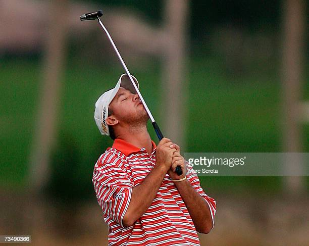 Golfer Boo Weekley reacts to missing a potential winning putt on the eighteenth hole during the final round of the Honda Classic on March 4 2007 at...