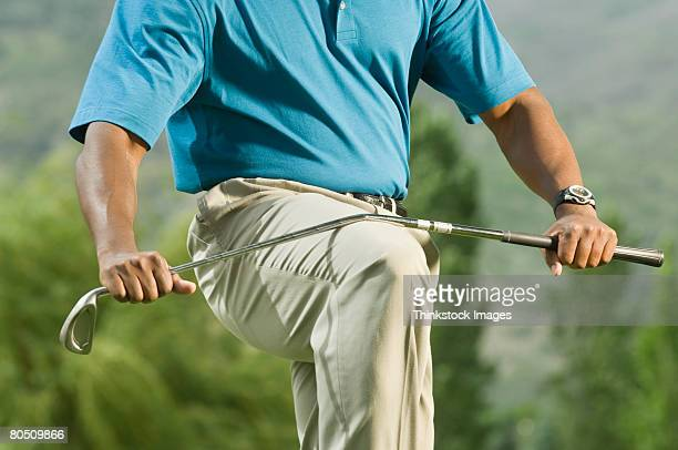 golfer breaking golf club - golf club stock pictures, royalty-free photos & images