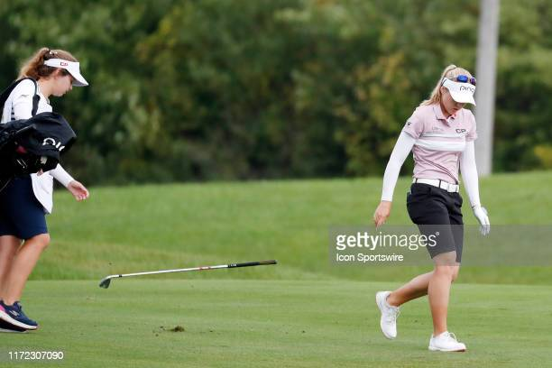LPGA golfer Brooke Henderson after hitting her second shot in a pot hole bunker gets upset and throws her club on the 8th hole during the final round...