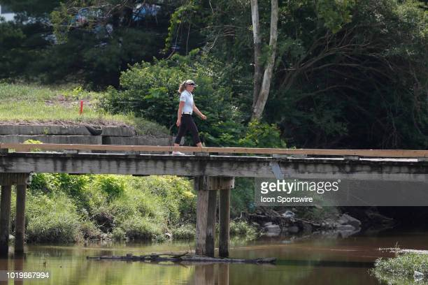 LPGA golfer Brooke Henderson crosses a bridge walking to the 9th tee during the final round of the Indy Women In Tech on August 19 2018 at the...