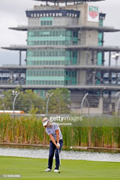 LPGA golfer Brooke Henderson hits a shot on the 16th hole with the iconic Indianapolis Motor Speedway Pagoda in the background during the second...