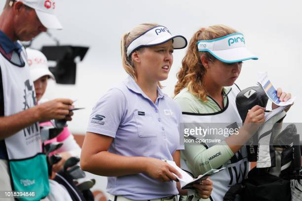 LPGA golfer Brooke Henderson looks at her yardage book on the 16th tee during the second round of the Indy Women In Tech on August 17 2018 at the...