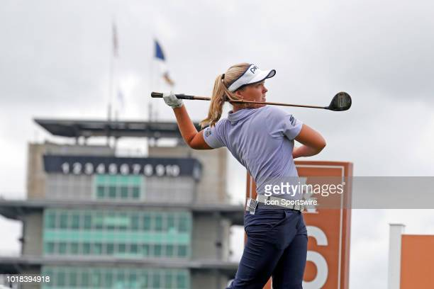 LPGA golfer Brooke Henderson tees off on the 16th hole with the iconic Indianapolis Motor Speedway Pagoda in the background during the second round...